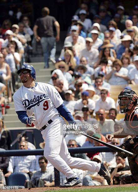 Jason Phillips of the Los Angeles Dodgers singled to left in the second inning allowing teammate Norihiro Nakamura to score against the San Francisco...