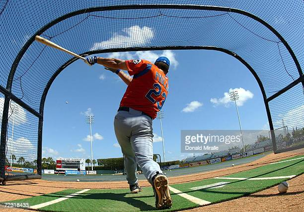 Jason Phillips of the New York Mets swings from the batting cage before his team's game against the Baltimore Orioles during Spring Training on March...