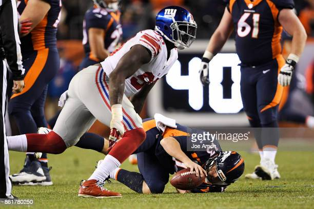 Jason PierrePaul of the New York Giants celebrates his sack on Trevor Siemian of the Denver Broncos during the fourth quarter of the on Sunday...
