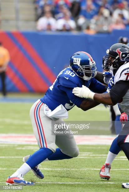 Jason Pierre-Paul of the New York Giants fights off the block of Duane Brown of the Houston Texans during an NFL football game September 21, 2014 at...