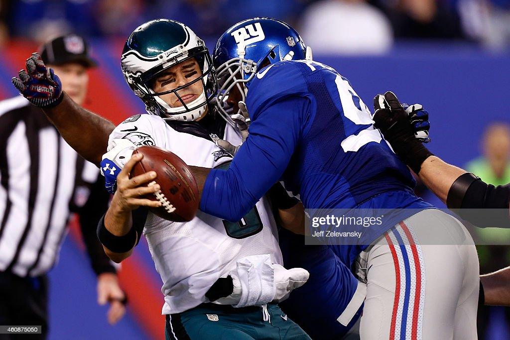 Jason Pierre-Paul #90 of the New York Giants sacks Mark Sanchez #3 of the Philadelphia Eagles during a game at MetLife Stadium on December 28, 2014 in East Rutherford, New Jersey.