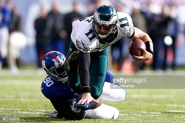 Jason PierrePaul of the New York Giants tackles Carson Wentz of the Philadelphia Eagles during the first quarter of the game at MetLife Stadium on...