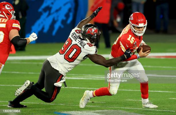 Jason Pierre-Paul of the Tampa Bay Buccaneers attempts to tackle Patrick Mahomes of the Kansas City Chiefs in the fourth quarter during Super Bowl LV...