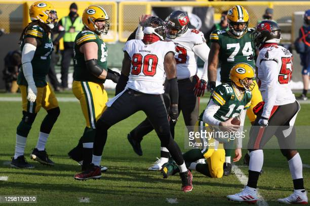 Jason Pierre-Paul of the Tampa Bay Buccaneers celebrates after sacking Aaron Rodgers of the Green Bay Packers in the first quarter during the NFC...