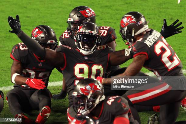 Jason Pierre-Paul of the Tampa Bay Buccaneers celebrates with his teammates after intercepting a pass thrown by Jared Goff of the Los Angeles Rams...