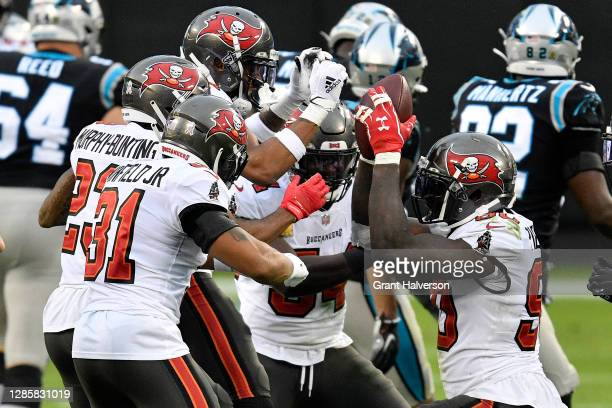 Jason Pierre-Paul of the Tampa Bay Buccaneers celebrates with his teammates after an interception of Teddy Bridgewater of the Carolina Panthers...
