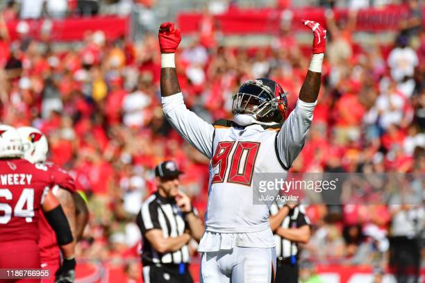 Jason Pierre-Paul of the Tampa Bay Buccaneers pumps up the crowd during a Arizona Cardinals third down in the second quarter of a football game at...