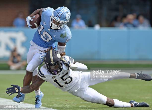 Jason Pinnock of the Pittsburgh Panthers knocks Dazz Newsome of the North Carolina Tar Heels outofbounds during their game at Kenan Stadium on...