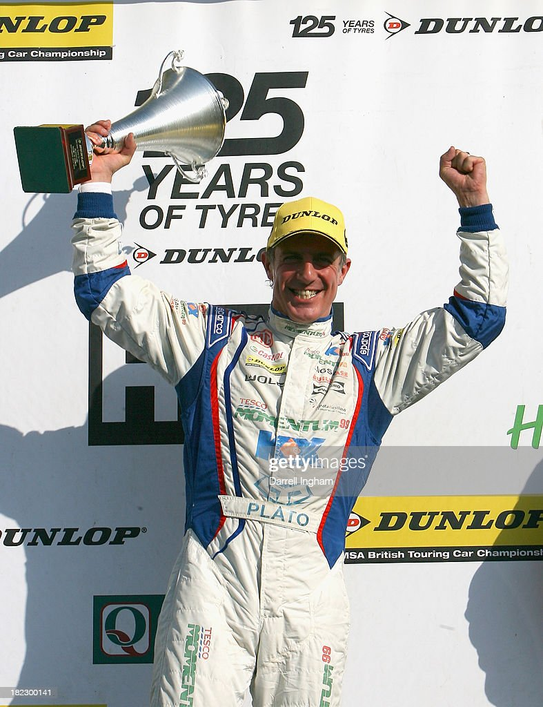 Jason Plato, driver of the #99 MG KX Momentum Racing MG6 celebrates his 80th victory after winning the Dunlop MSA British Touring Car Championship race at the Silverstone Circuit on September 29, 2013 in Towcester, United Kingdom.
