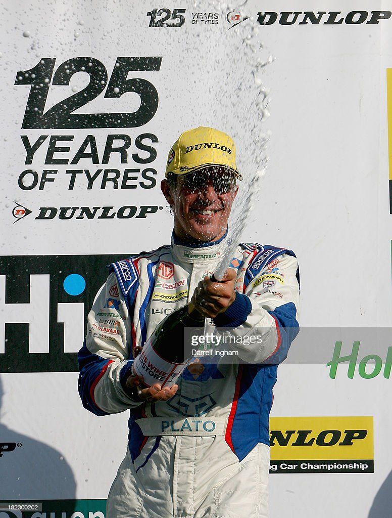 Jason Plato, driver of the #99 MG KX Momentum Racing MG6 sprays champagne to celebrate his 80th victory after winning the Dunlop MSA British Touring Car Championship race at the Silverstone Circuit on September 29, 2013 in Towcester, United Kingdom.