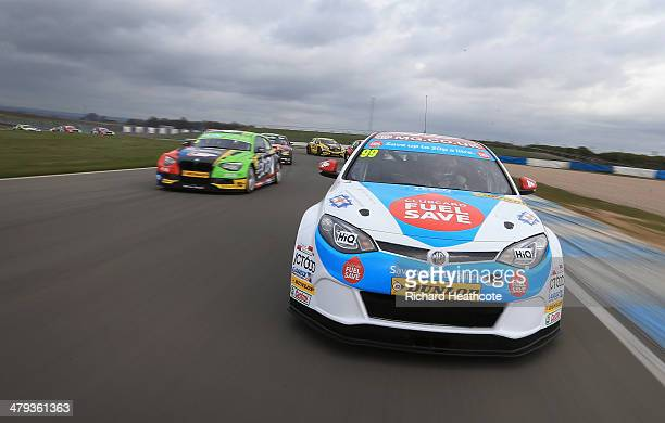 Jason Plato in the MG KX Clubcard Fuel Save MG6 leads the pack around on a display lap during the 2014 Dunlop MSA British Touring Car Championship...