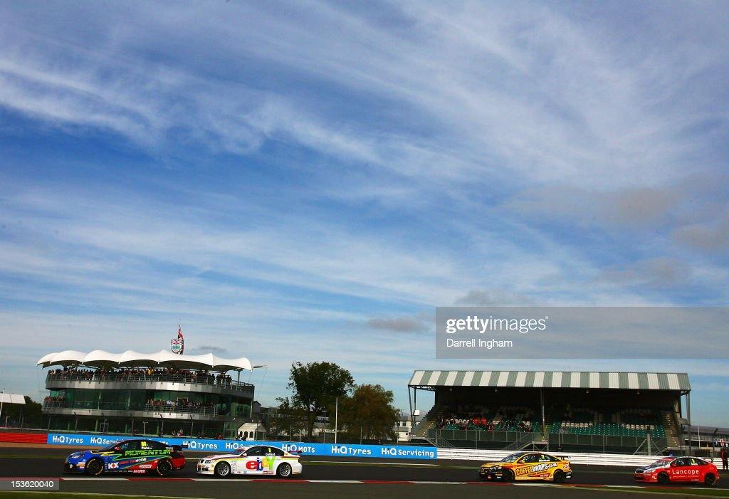 Jason Plato of Great Britain drives the #99 MG KX Momentum Racing MG6 ahead of #8 Rob Collard and #17 Dave Newham during the Dunlop MSA British Touring Car Championship race at the Silverstone Circuit on October 7, 2012 in Towcester, United Kingdom.