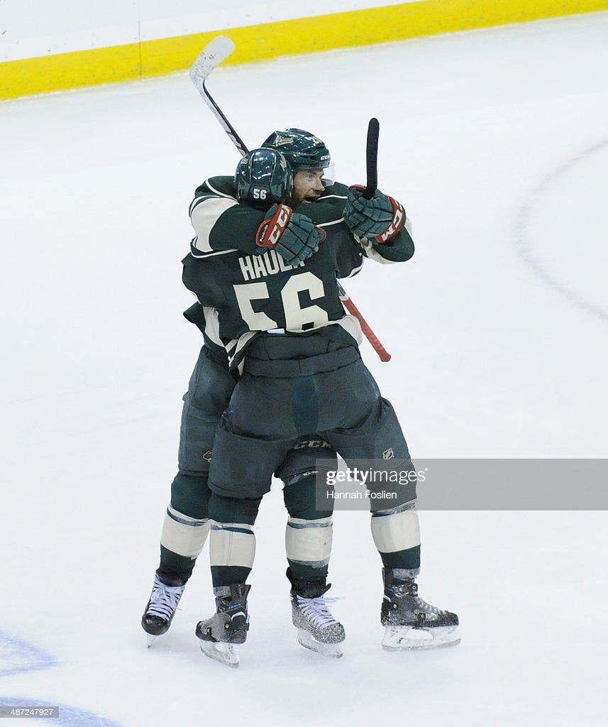 Jason Pominville #29 and Erik Haula #56 of the Minnesota Wild celebrate an empty net goal against the Colorado Avalanche by Pominville during the third period in Game Six of the First Round of the 2014 NHL Stanley Cup Playoffs on April 28, 2014 at Xcel Energy Center in St Paul, Minnesota. The Wild defeated the Avalanche 5-2.