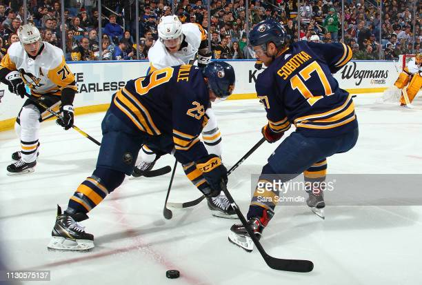 Jason Pominville and Vladimir Sobotka of the Buffalo Sabres battle for the puck against Evgeni Malkin and Zach Trotman of the Pittsburgh Penguins...