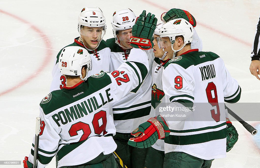 Jason Pominville #29, Charlie Coyle #3, Ryan Suter #20, Zach Parise #11 and Mikko Koivu #9 of the Minnesota Wild celebrate a second-period goal against the Winnipeg Jets at the MTS Centre on April 7, 2014 in Winnipeg, Manitoba, Canada.