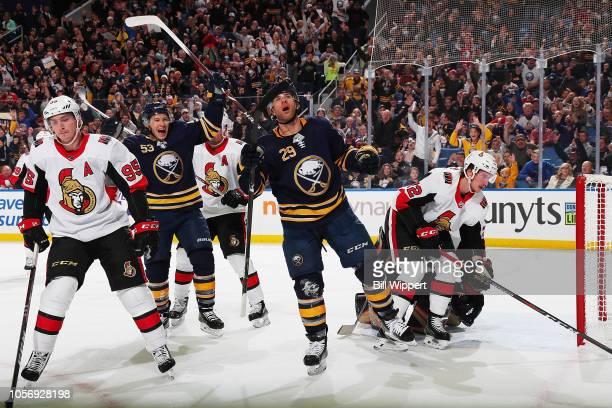 Jason Pominville of the Buffalo Sabres celebrates his first period goal against the Ottawa Senators with Jeff Skinner during an NHL game on November...
