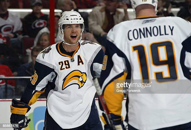 Jason Pominville of the Buffalo Sabres celebrates his second goal of the game with teammate Tim Connolly during a NHL game against the Carolina...