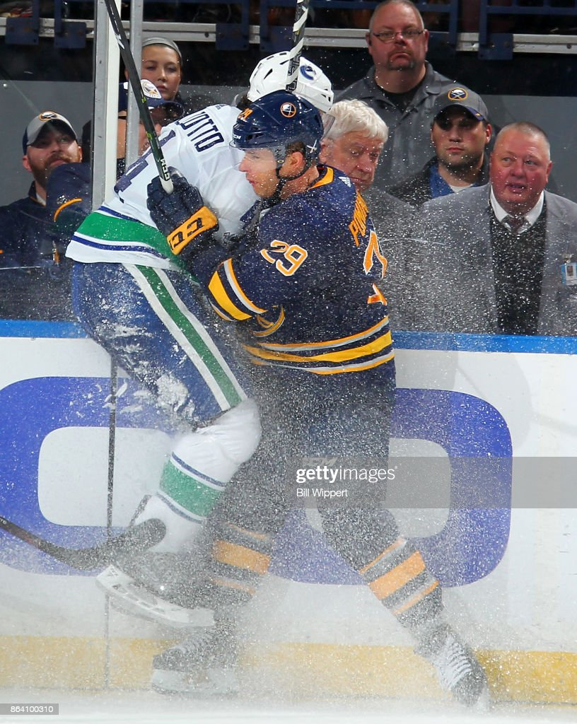 Jason Pominville #29 of the Buffalo Sabres checks Michael Del Zotto #4 of the Vancouver Canucks during an NHL game on October 20, 2017 at KeyBank Center in Buffalo, New York. Vancouver won, 4-2.