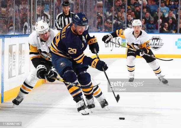 Jason Pominville of the Buffalo Sabres controls the puck against Evgeni Malkin of the Pittsburgh Penguins during an NHL game on March 14 2019 at...