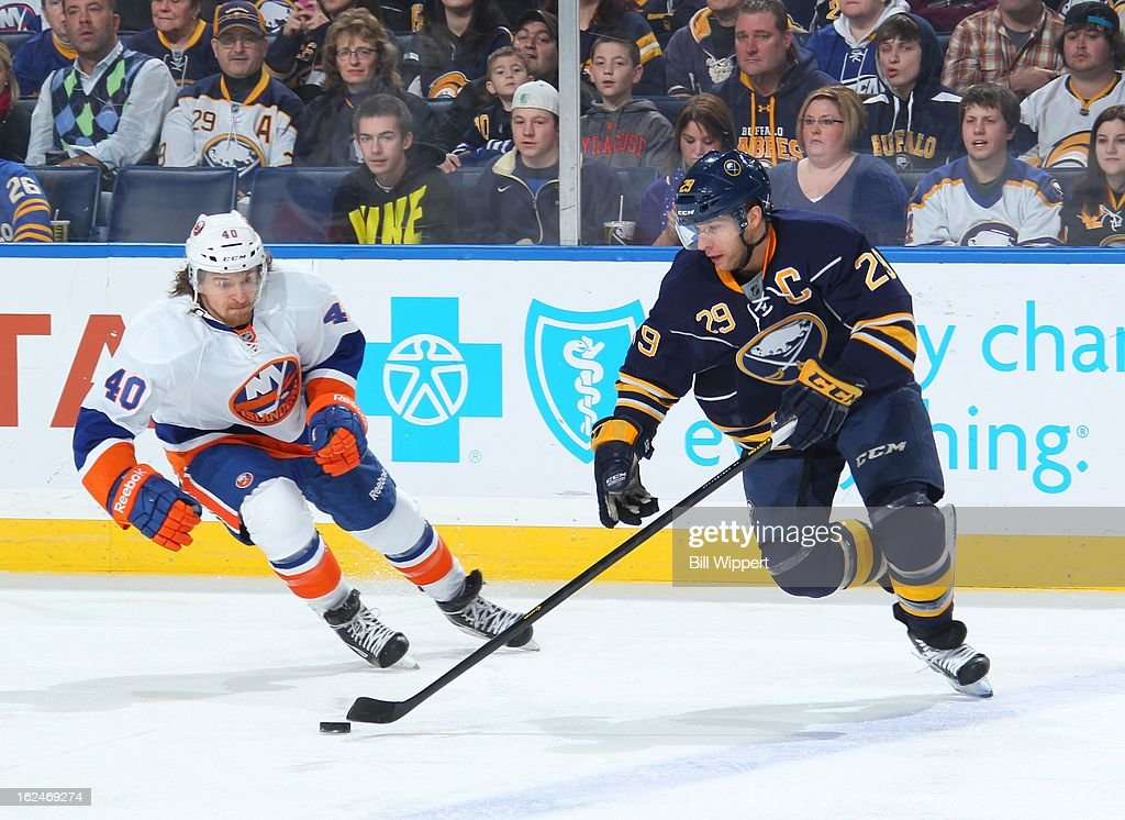 Jason Pominville #29 of the Buffalo Sabres controls the puck against Michael Grabner #40 of the New York Islanders on February 23, 2013 at the First Niagara Center in Buffalo, New York.