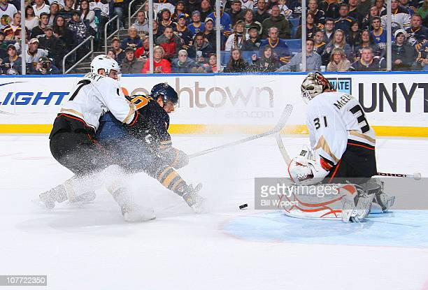 Jason Pominville of the Buffalo Sabres gets stopped by Lubomir Visnovsky and Curtis McElhinney of the Anaheim Ducks at HSBC Arena on December 21,...