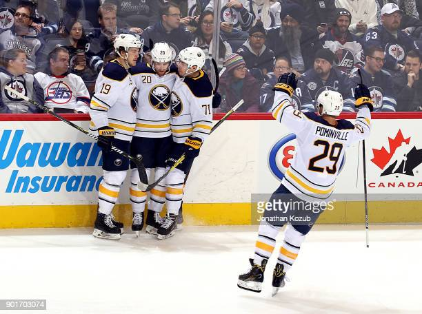 Jason Pominville of the Buffalo Sabres joins teammates Jake McCabe Scott Wilson and Evan Rodrigues as they celebrate a third period goal against the...