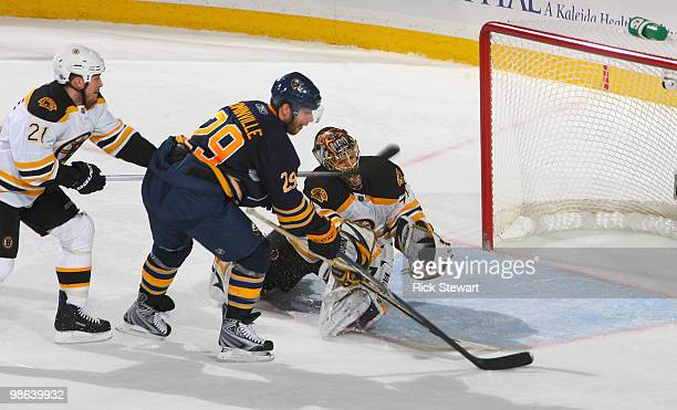 Jason Pominville of the Buffalo Sabres readies to score Buffalo's second goal in the first period against Andrew Ferrence and Tuukka Rask of the...