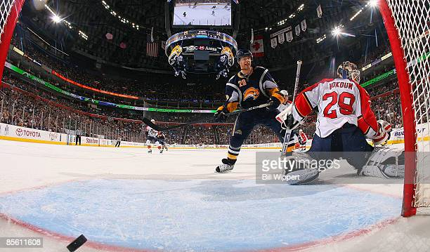 Jason Pominville of the Buffalo Sabres scores a third period goal past Tomas Vokoun of the Florida Panthers on March 25, 2009 at HSBC Arena in...