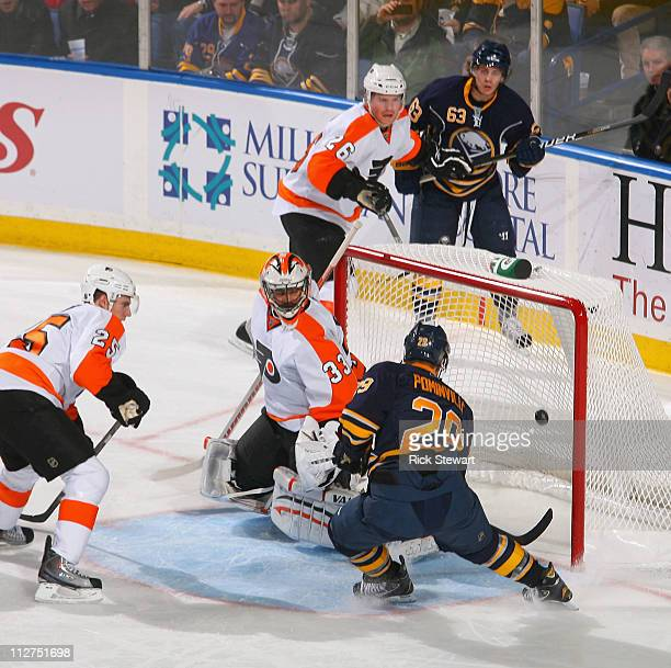 Jason Pominville of the Buffalo Sabres scores Buffalo's first goal against Brian Boucher of the Philadelphia Flyers in Game Four of the Eastern...
