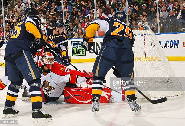 Jason Pominville of the Buffalo Sabres scores his first-period goal by banking the puck off the skate of goaltender Tomas Vokoun of the Florida...