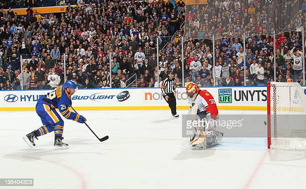 Jason Pominville of the Buffalo Sabres scores the game winning overtime goal against Scott Clemmensen of the Florida Panthers at First Niagara Center...