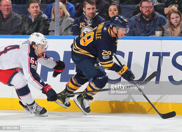Jason Pominville of the Buffalo Sabres skates against Tyler Motte of the Columbus Blue Jackets during an NHL game on November 20 2017 at KeyBank...