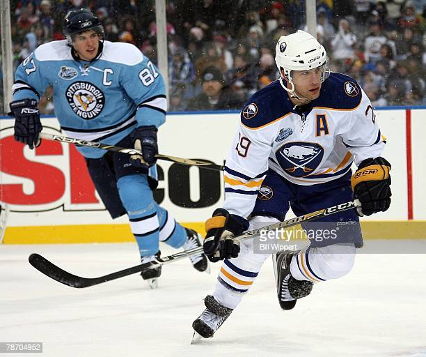 Jason Pominville of the Buffalo Sabres skates past Sidney Crosby of the Pittsburgh Penguins in the NHL Winter Classic on January 1 2008 at Ralph...