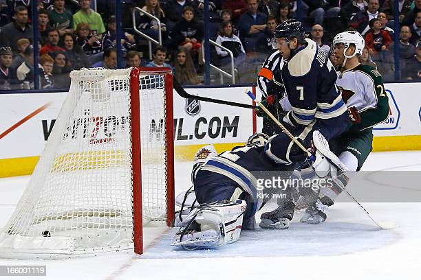 Jason Pominville of the Minnesota Wild beats Jack Johnson and Sergei Bobrovsky of the Columbus Blue Jackets for his first goal as a member of the...