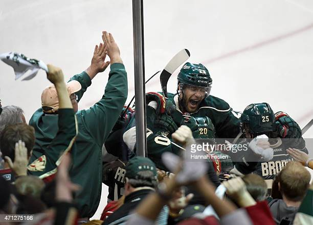 Jason Pominville of the Minnesota Wild celebrates a goal by teammate Zach Parise against the St Louis Blues during the third period in Game Six of...
