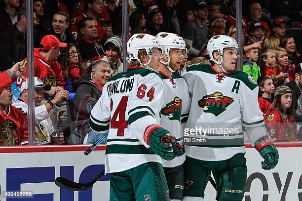 Jason Pominville of the Minnesota Wild celebrates with Mikael Granlund and Zach Parise after scoring against the Chicago Blackhawks in the first...