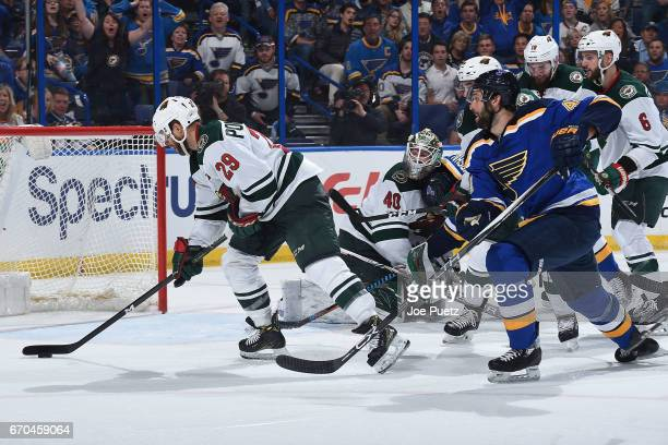 Jason Pominville of the Minnesota Wild defends the net against Robert Bortuzzo of the St Louis Blues in Game Four of the Western Conference First...