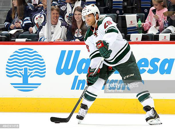Jason Pominville of the Minnesota Wild takes part in the pregame warm up prior to NHL action against the Winnipeg Jets at the MTS Centre on October...