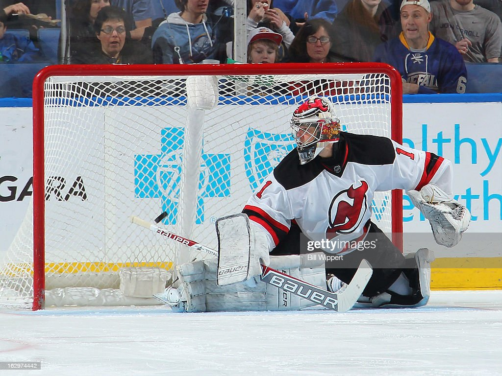 Jason Pominville (not pictured) scores a second period goal on Johan Hedberg #1 of the New Jersey Devils on March 2, 2013 at the First Niagara Center in Buffalo, New York.
