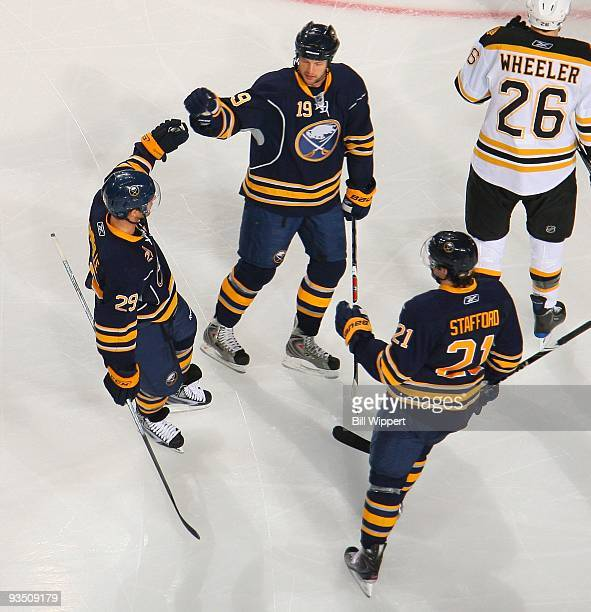 Jason Pominville Tim Connolly and Drew Stafford of the Buffalo Sabres celebrate a goal against the Boston Bruins on November 20 2009 at HSBC Arena in...