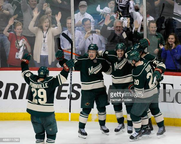 Jason Pominville, Zach Parise, Mikael Granlund, Jonas Brodin and Ryan Suter of the Minnesota Wild celebrate a goal by Granlund against the Chicago...