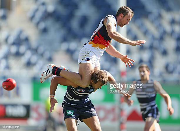 Jason Porplyzia of the Crows attempts to take a mark on the shoulders of Corey Enright of the Cats during the round two AFL NAB Cup match between the...
