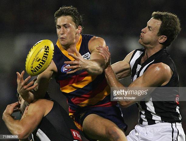 Jason Porplyzia of the Crows marks of James Clement of the Magpies during the round 18 AFL match between the Adelaide Crows and the Collingwood...