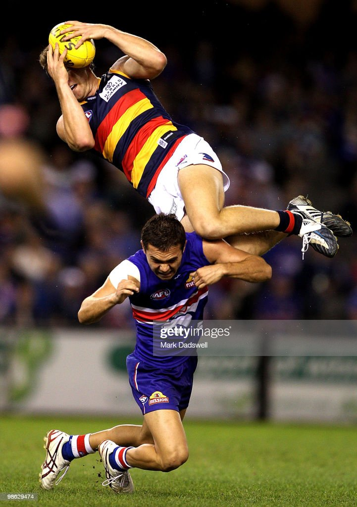 Jason Porplyzia of the Crows marks over Jarrod Harbrow of the Bulldogs during the round five AFL match between the Western Bulldogs and the Adelaide Crows at Etihad Stadium on April 23, 2010 in Melbourne, Australia.