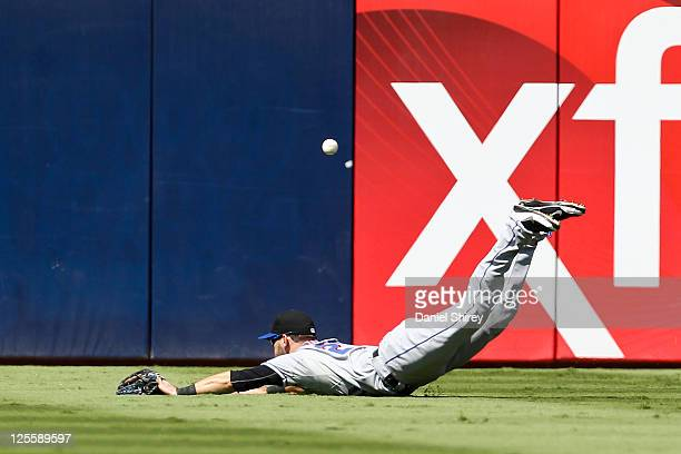 Jason Pridie of the New York Mets makes a diving attempt to catch a fly ball in the second inning of the game against the Atlanta Braves at Turner...