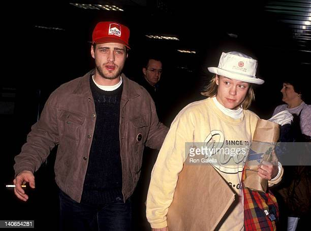 Jason Priestley and Christine Elise at the Jason Priestley and Christine Elise at Los Angeles International Airport Los Angeles International Airport...