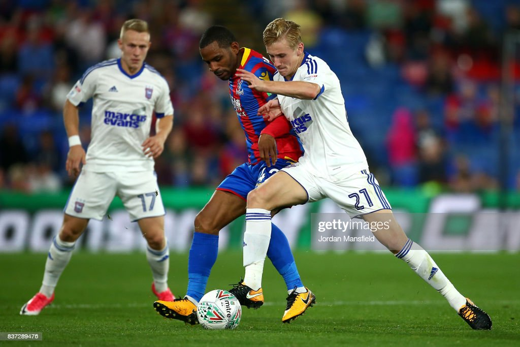 Jason Puncheon of Crystal Palace and Flynn Downes of Ipswich battle for possession during the Carabao Cup Second Round match between Crystal Palace and Ipswich Town at Selhurst Park on August 22, 2017 in London, England.