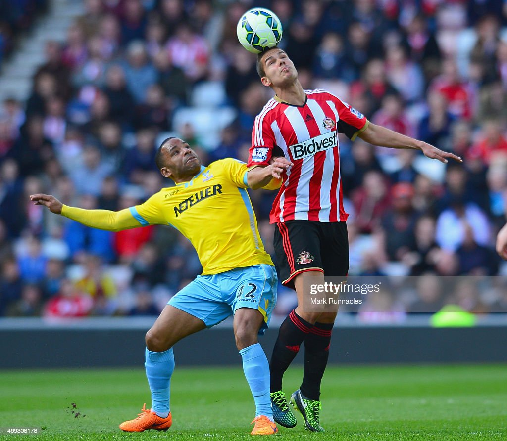 Jason Puncheon of Crystal Palace and Jack Rodwell of Sunderland battle for the ball during the Barclays Premier League match between Sunderland and Crystal Palace at Stadium of Light on April 11, 2015 in Sunderland, England.