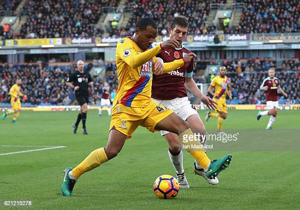 Jason Puncheon of Crystal Palace and Jon Flanagan of Burnley battle for possession during the Premier League match between Burnley and Crystal Palace...