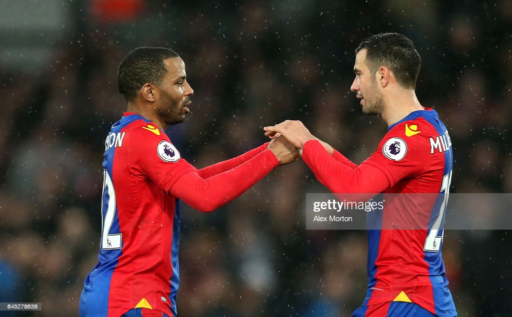 Jason Puncheon of Crystal Palace (L) and Luka Milivojevic of Crystal Palace (R) embrace after the Premier League match between Crystal Palace and Middlesbrough at Selhurst Park on February 25, 2017 in London, England.